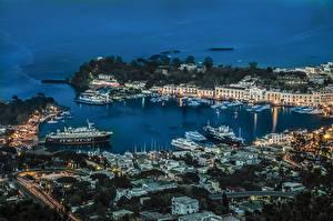 Фотографии Италия Здания Вечер Пирсы Корабли Залив Ischia Города