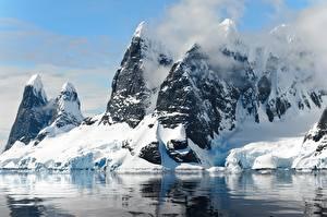 Фотография Горы Зима Утес Снег Природа