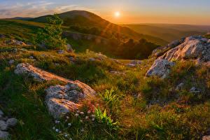 Картинки Россия Крым Осенние Рассветы и закаты Камень Холмы Трава Солнце Природа