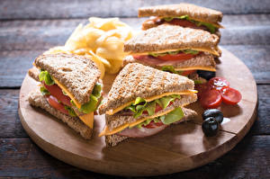 Картинки Сэндвич Фастфуд Хлеб Оливки Овощи Разделочная доска Пища