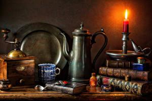 Фотографии Натюрморт Свечи Чайник Книга Чашка Ложка Пища