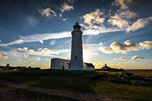 Картинки Рассветы и закаты Небо Берег Маяки