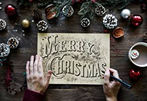 Фотографии Рождество Шар Шишки Руки Шариковая ручка Английский