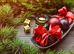 Фото Новый год Ветки Подарки Бантик Шарики