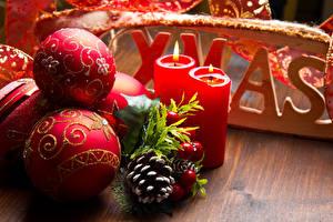 Фотографии Рождество Свечи Шар Шишки