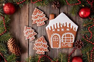 Картинки Новый год Печенье Здания Доски Ветка Шишки Шарики Дизайна Елка Продукты питания