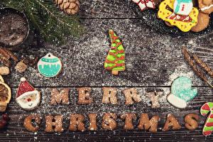 Фотография Новый год Печенье Сахарная пудра Доски Английский Дизайн Елка Санта-Клаус Рукавицы Пища