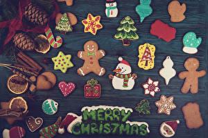 Картинка Рождество Печенье Доски Английский Дизайн Снеговики Шишки Рукавицы Новогодняя ёлка Пища