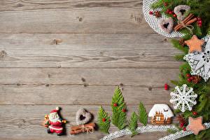 Картинка Новый год Выпечка Печенье Корица Здания Доски Ветки Дизайна Снежинка Сердце Санта-Клаус Пища