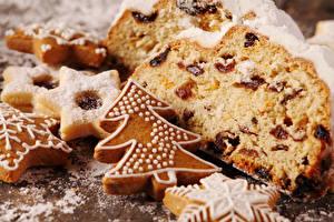 Фото Новый год Выпечка Печенье Кекс Вблизи Изюм Елка Пища