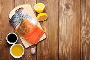 Картинки Рыба Лимоны Чеснок Укроп Доски Разделочная доска Пища