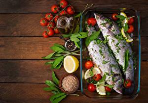 Фотография Рыба Томаты Лимоны Приправы Доски Пища