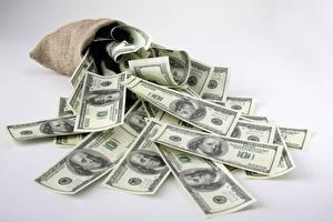 Фотографии Деньги Купюры Доллары Много Серый фон