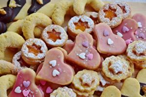 Фото Выпечка Печенье Сахарная пудра Сердце Звездочки Продукты питания