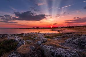 Фотография Рассветы и закаты Побережье Камни Пейзаж Лучи света