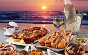 Фото Рассвет и закат Морепродукты Омары Море Креветки Солнце Еда