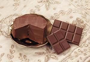 Фотографии Шоколад Шоколадная плитка Масло Тарелка Еда