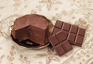 Фотографии Шоколад Шоколадная плитка Масло Тарелка