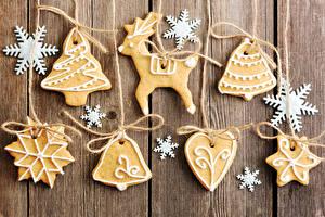 Картинки Рождество Печенье Олени Доски Дизайн Снежинки Новогодняя ёлка Колокольчики Пища