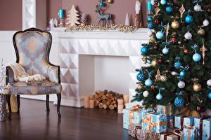 Картинки Новый год Интерьер Кресло Новогодняя ёлка Шарики Подарки