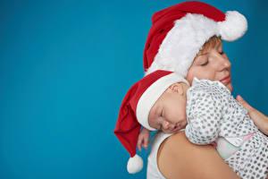 Картинки Рождество Мама Цветной фон Младенцы Шапка Спят ребёнок Девушки