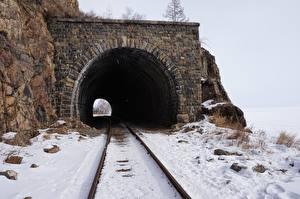 Картинки Железные дороги Зима Камень Рельсы Снег Туннель Berezovsky-pass tunnel