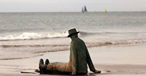 Фотография Скульптуры Пляж Шляпа Сидящие