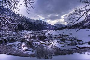 Фото Швейцария Здания Зима Горы Снег Glarus Города