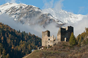 Фотографии Швейцария Горы Лес Замок Развалины Снеге Туман Chanov Castle, Graubünden Природа