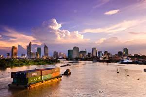Картинка Вьетнам Рассвет и закат Небоскребы Корабль Пристань Контейнеровоз Заливы Saigon Города