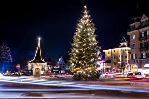 Картинки Австрия Новый год Здания Зимние Улице Елка Гирлянда В ночи Pörtschach Города