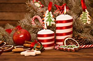 Фотографии Рождество Яблоки Свечи Пламя Ветвь