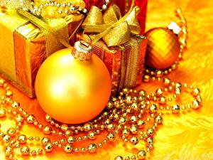 Картинки Рождество Шар Подарки Золотые