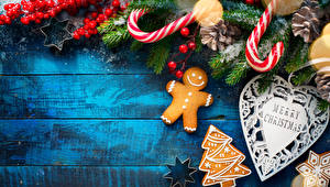 Фото Новый год Ягоды Печенье Ветвь Английский Елка Сердечко Пища