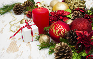 Фотографии Рождество Свечи Шишки Шар Подарки