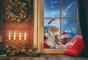 Фото Новый год Свечи Окно Шишки Санта-Клаус Подарков