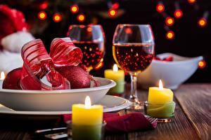 Фотография Новый год Шампанское Свечи Бокалы Бантик Еда