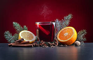 Картинка Новый год Корица Апельсин Лимоны Орехи Бадьян звезда аниса Напитки Стакан Еда