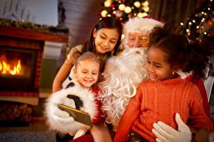 Фотографии Рождество Санта-Клаус Девочки Ребёнок