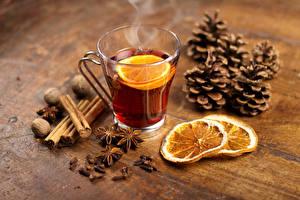 Фото Новый год Чай Лимоны Корица Бадьян звезда аниса Орехи Чашка Шишки Пища