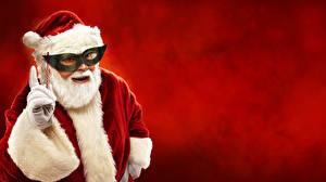 Фотография Маски Красный фон Санта-Клаус Шапки Борода Перчатки