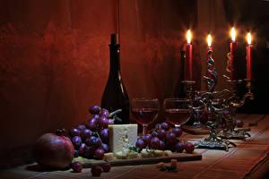 Фото Натюрморт Свечи Вино Виноград Сыры Гранат Бутылка Бокалы Еда