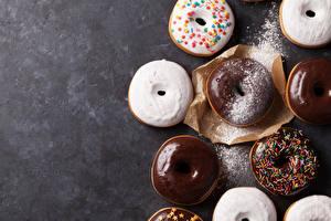 Фотография Пончики Шоколад Выпечка Сахарная пудра Пища
