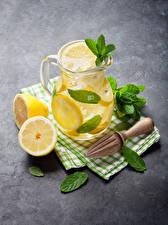 Фото Напитки Лимоны Лимонад Кувшин Листва Пища