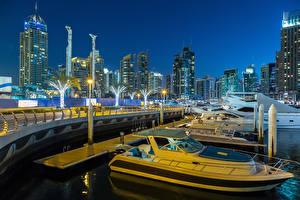 Фотографии Дубай Объединённые Арабские Эмираты Здания Небоскребы Мосты Вечер Катера Уличные фонари Города