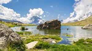 Картинка Швейцария Озеро Лето Камни Пейзаж Трава Lake Stellisee Природа