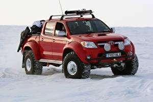 Фотографии Тойота Пикап кузов Красный Металлик 2007 Arctic Trucks Hilux Invincible AT38 машины