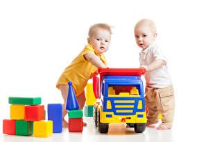 Фотографии Игрушка Белый фон Двое Мальчик Грудной ребёнок Дети