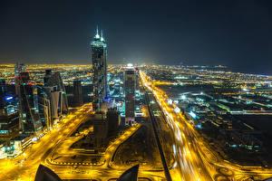 Фото Объединённые Арабские Эмираты Дубай Небоскребы Дороги Мегаполиса В ночи Города
