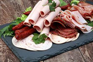 Картинки Мясные продукты Колбаса Ветчина Нарезка Еда